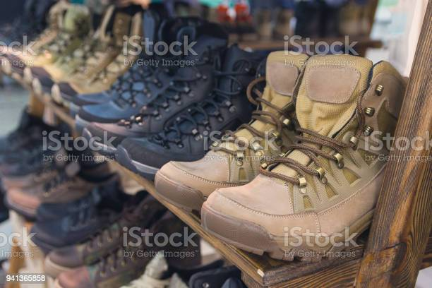 Army boots are in line at the store counter shoes picture id941365858?b=1&k=6&m=941365858&s=612x612&h=i y 6rmcr8gt0imvdym1efc4qovxftyvxhad3pj 8r8=