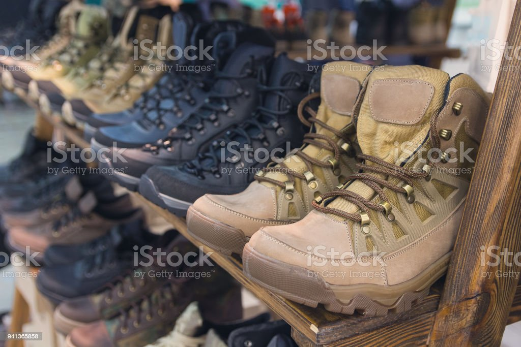 Army boots are in line at the store counter. Shoes stock photo