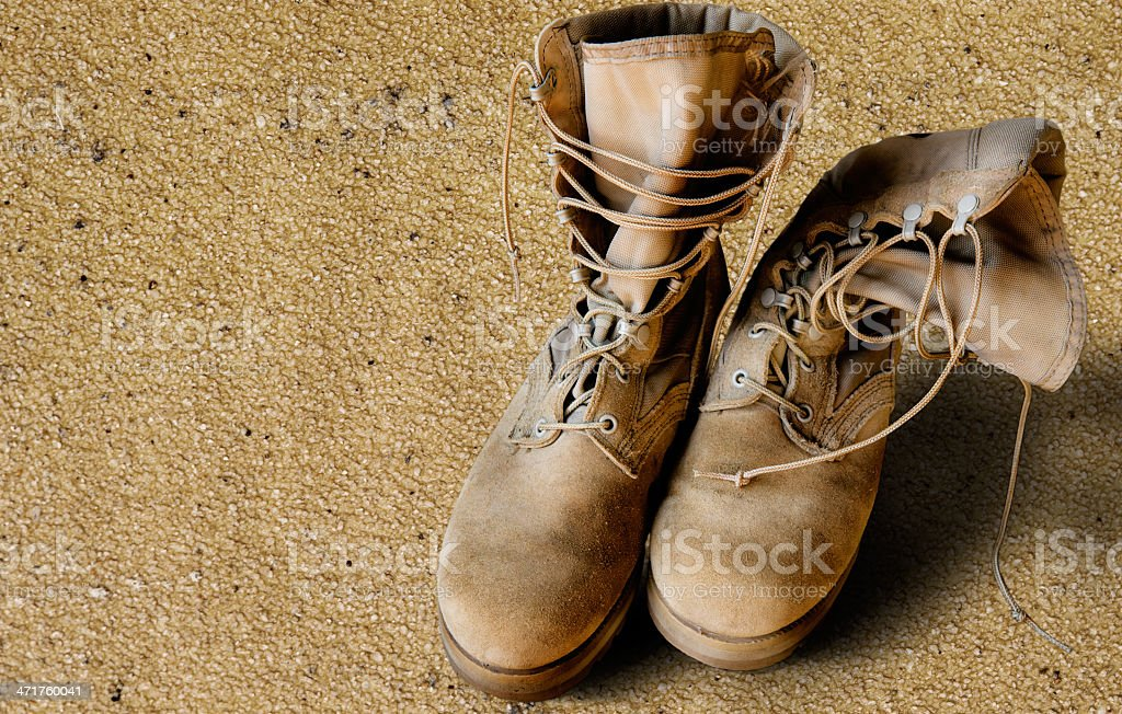 US Army boots on sand stock photo