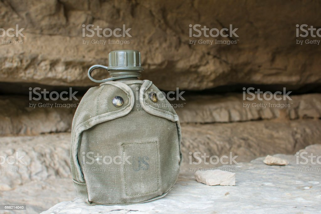 U.S. army canteen in cave stock photo