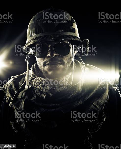 Army Captain Deploying In Combat Zone Stock Photo - Download Image Now