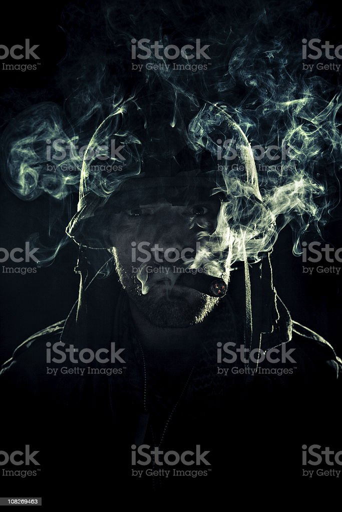 army captain puffing smoke stock photo