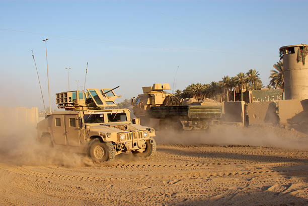 army car going to its base on a dirty road - land vehicle stock photos and pictures