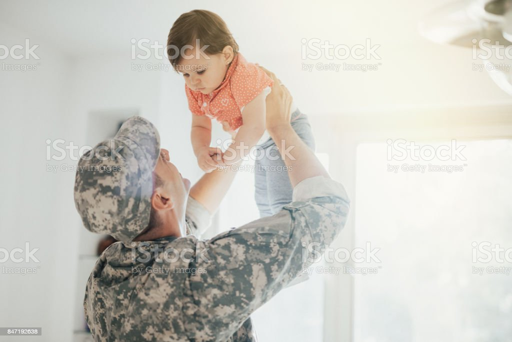 Army Dad Reunites With His Little Girl stock photo
