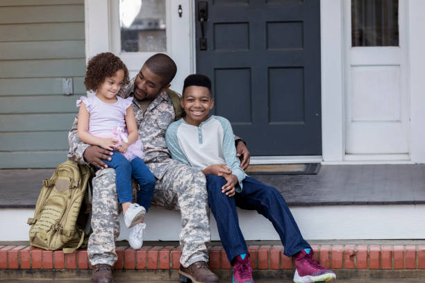 Army dad talks with his kids before his deployment stock photo