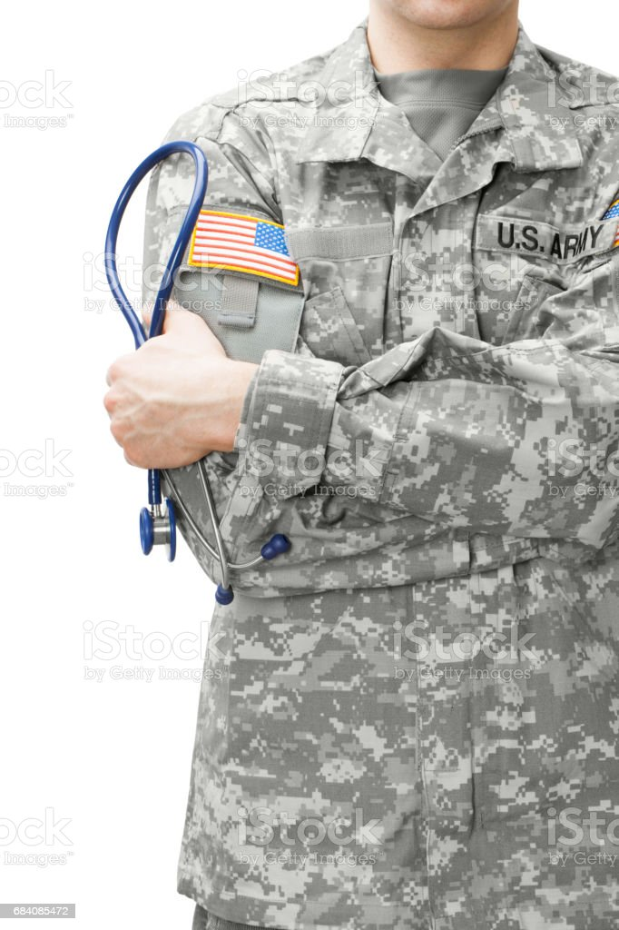 US Army doctor holding stethoscope next to his shoulder stock photo