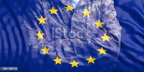 istock EU Army. European Union flag and faded soldier with crossed arms. 3d illustration 1061766724