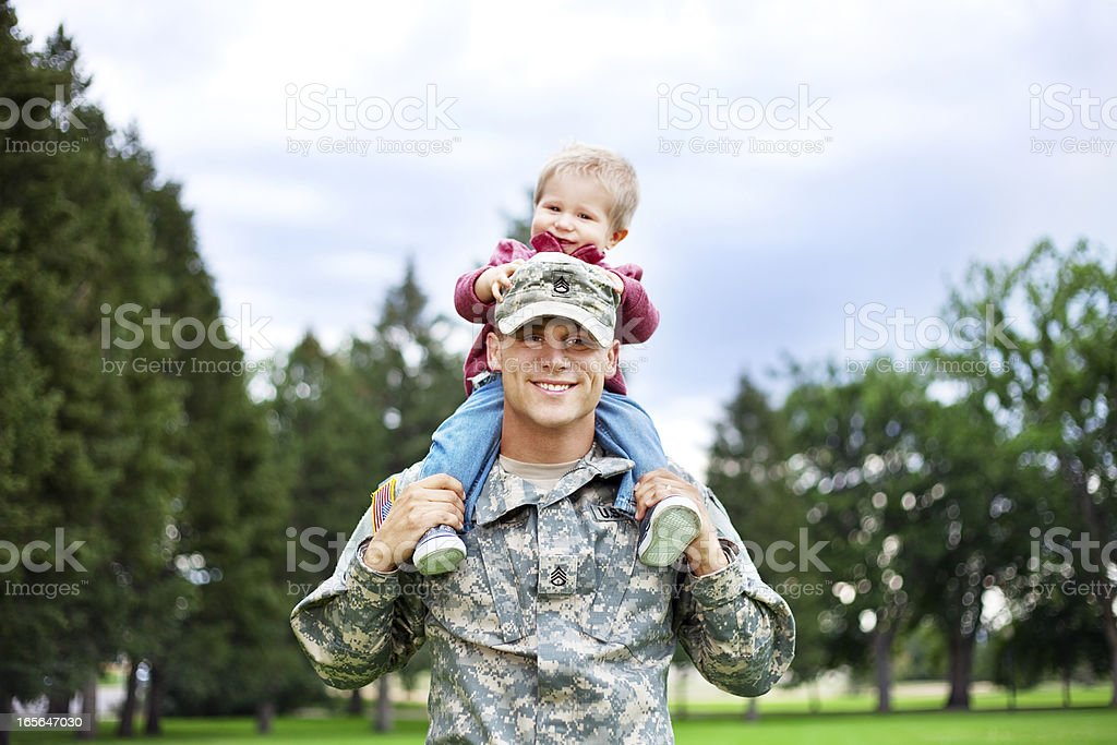Army Family Series: Real American Soldier With Son royalty-free stock photo