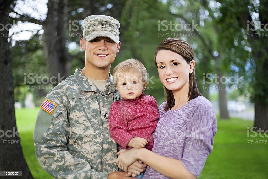Army Family Series: Real American Soldier With Wife & Son stock photo