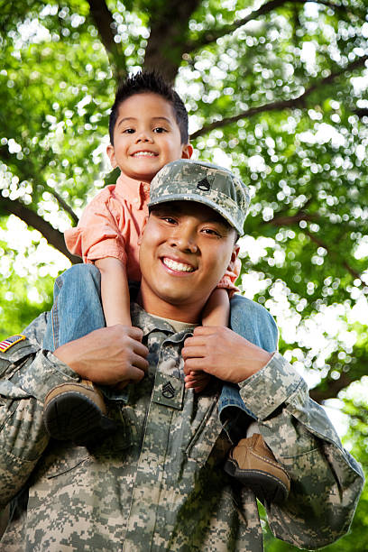 Army Family Series: Young American Soldier & Son stock photo
