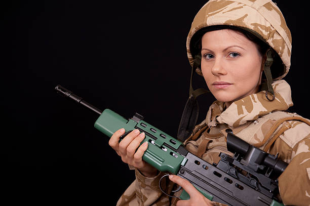 army girl with rifle - uk military stock photos and pictures