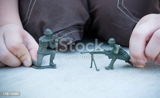 Child playing with army guys