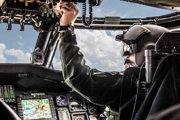 Army Helicopter Pilot riding Black  helicopter Army Helicopter Pilot riding Black  helicopter pilot stock pictures, royalty-free photos & images