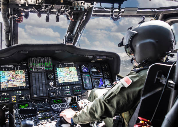 Army Helicopter Pilot riding helicopter stock photo