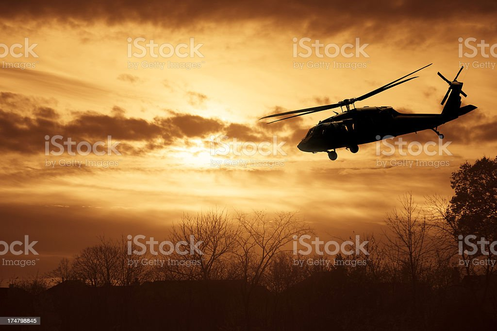 Army Helicopter Silhouette at Sunset royalty-free stock photo