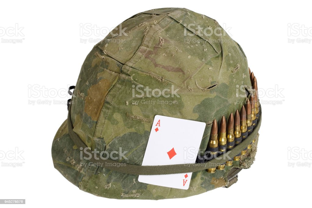 Us Army Helmet Vietnam War Period With Camouflage Cover Ammo Belt And Amulet Playing Card Ace Of Diamonds Stock Photo Download Image Now Istock