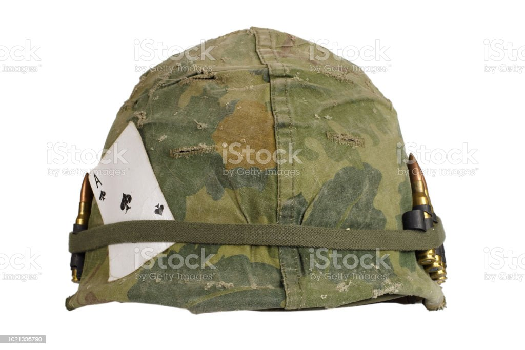 US Army helmet Vietnam war period with camouflage cover and ammo belt and amulet - the ace of spades playing card – zdjęcie