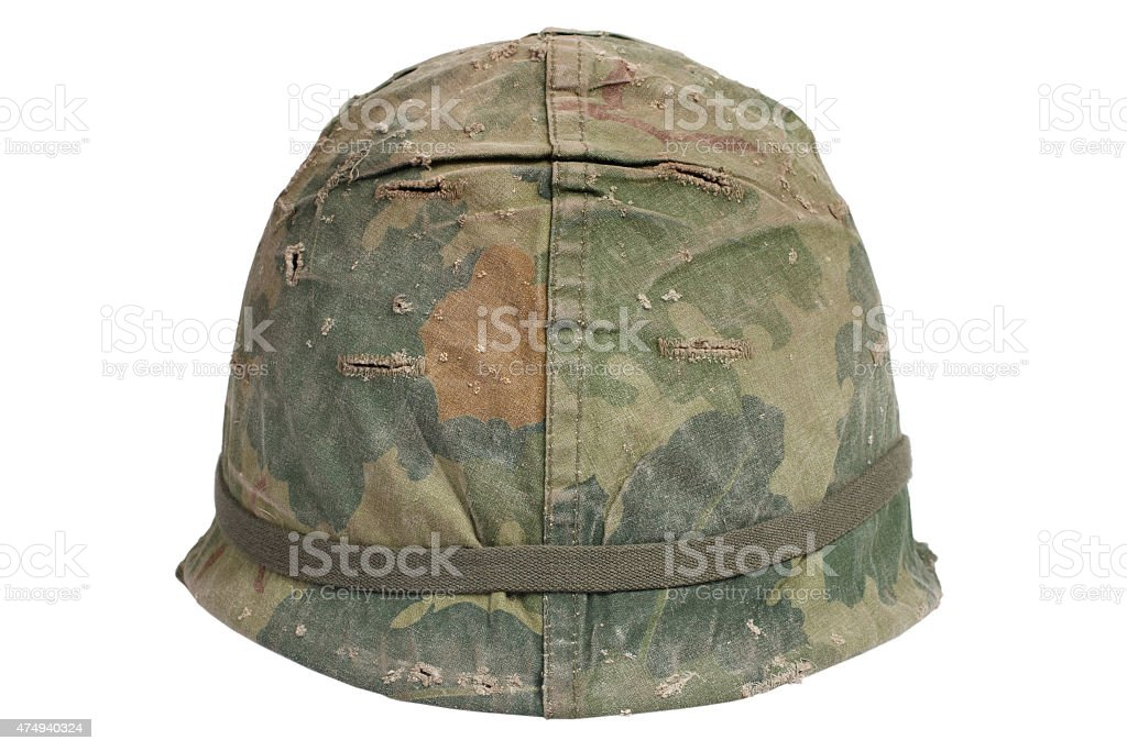 US Army M1 helmet with camouflage cover Vietnam war period stock photo
