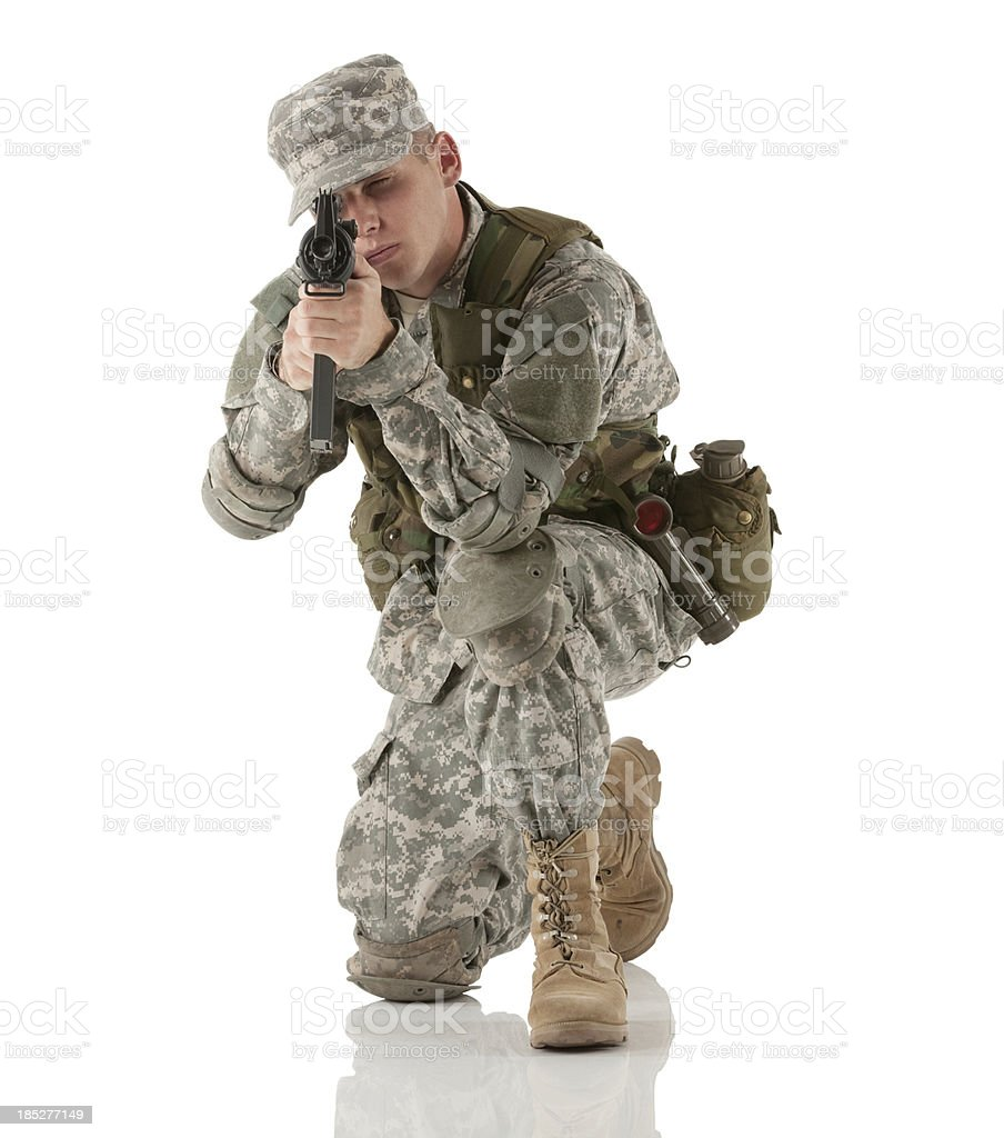 Army man aiming with a rifle stock photo