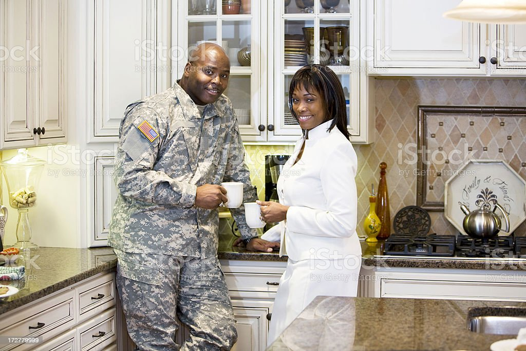 Army man and wife happily enjoying a cup of coffee stock photo