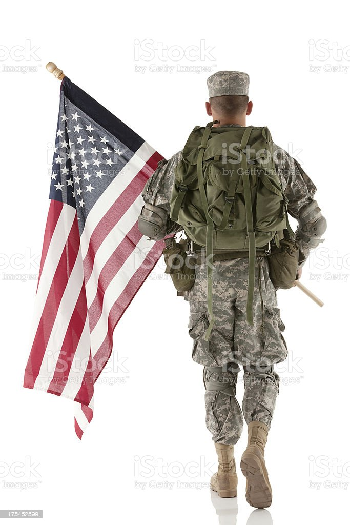 Army man carrying an American flag stock photo