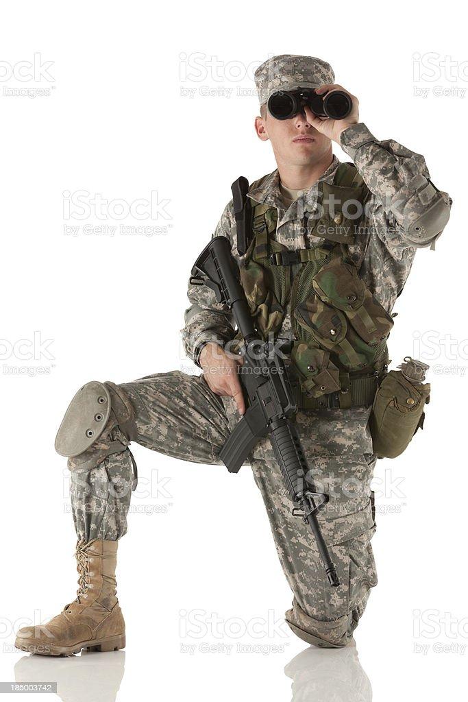 Army man looking through binoculars royalty-free stock photo