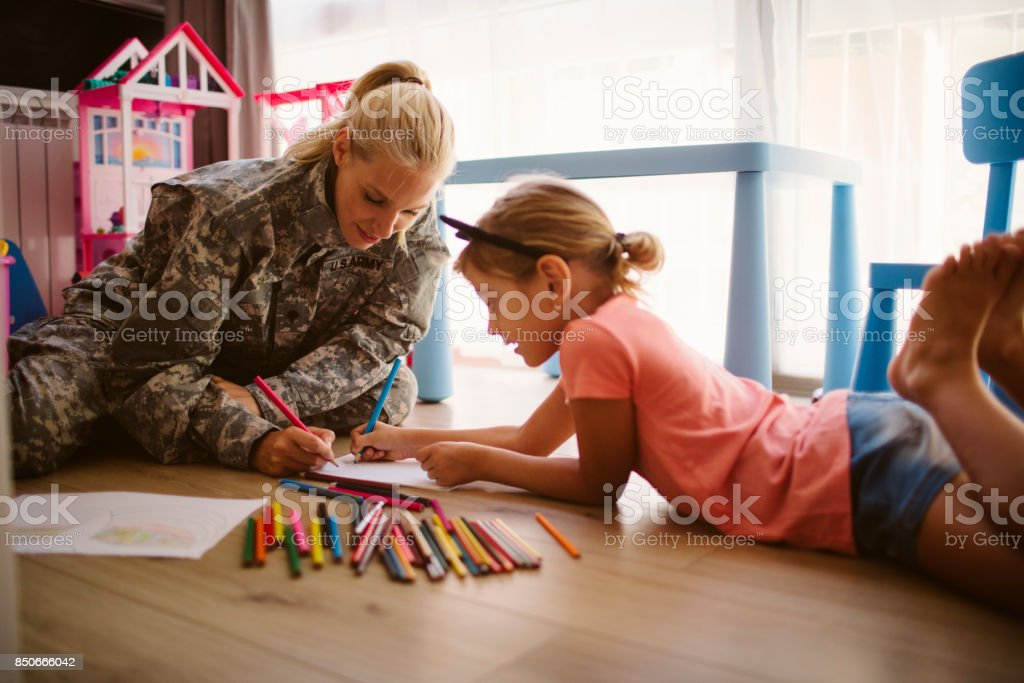 Army Mom Coloring  With Her Little Girl stock photo