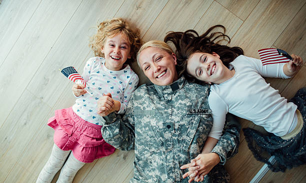 army mom reunites with her little girls. - armed forces stock photos and pictures