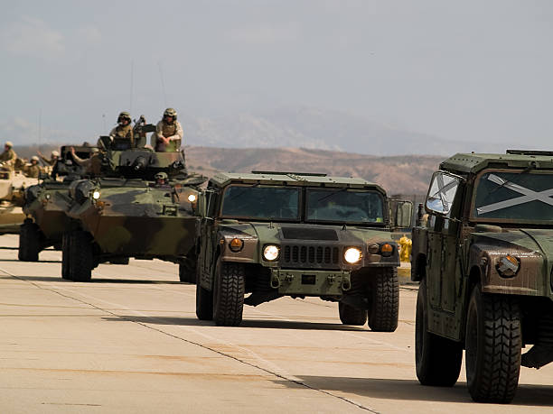 """US army moves forward """"MCAS Miramar, CA, USA - October 21, 2008:US military moving on Humvees demonstrating their skills."""" us military stock pictures, royalty-free photos & images"""