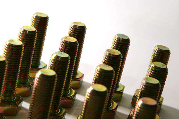 Army of bolts lined up in a square formation  washer fastener stock pictures, royalty-free photos & images