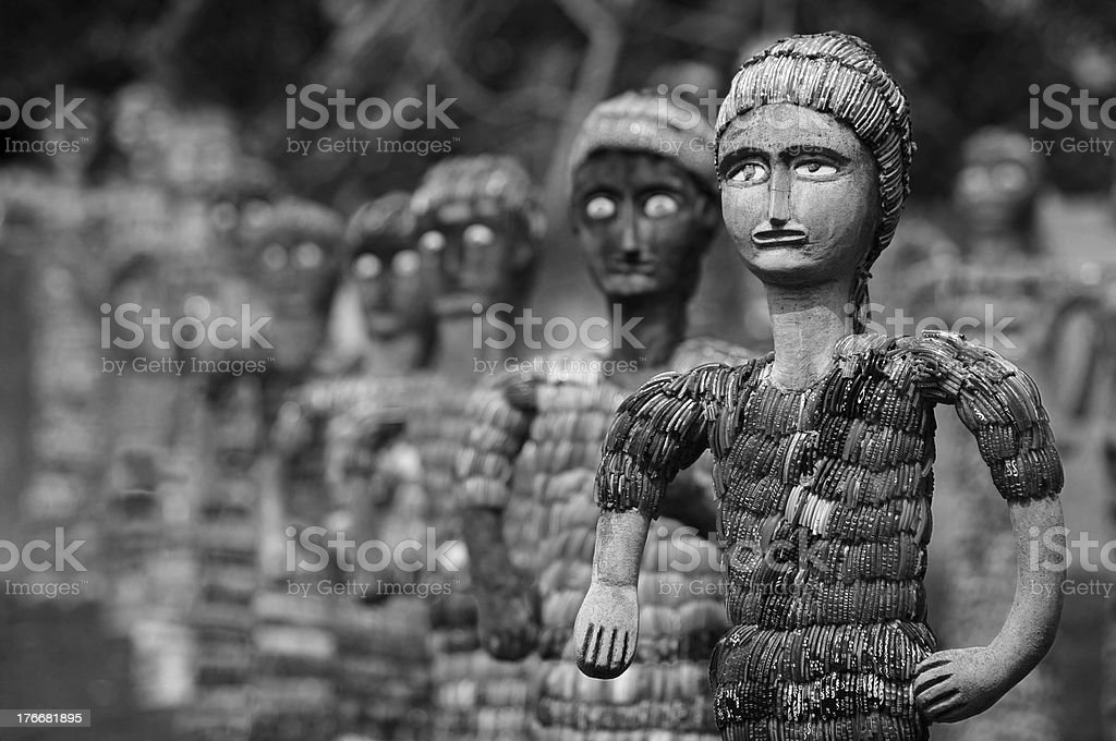 army of statuettes, black and white stock photo