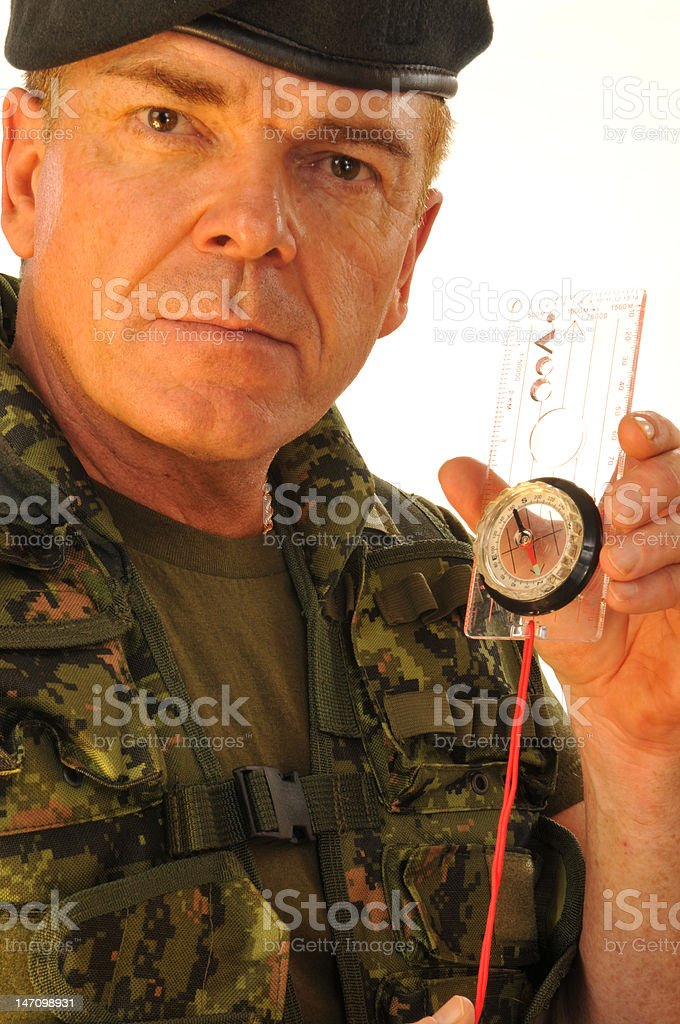 Army Officer  and orienteering compass wearing a beret royalty-free stock photo