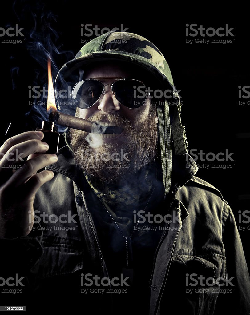 army officer lit a cigar royalty-free stock photo