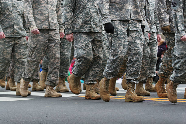 Army Parade Soldiers dressed in army camouflage in an army parade us military stock pictures, royalty-free photos & images