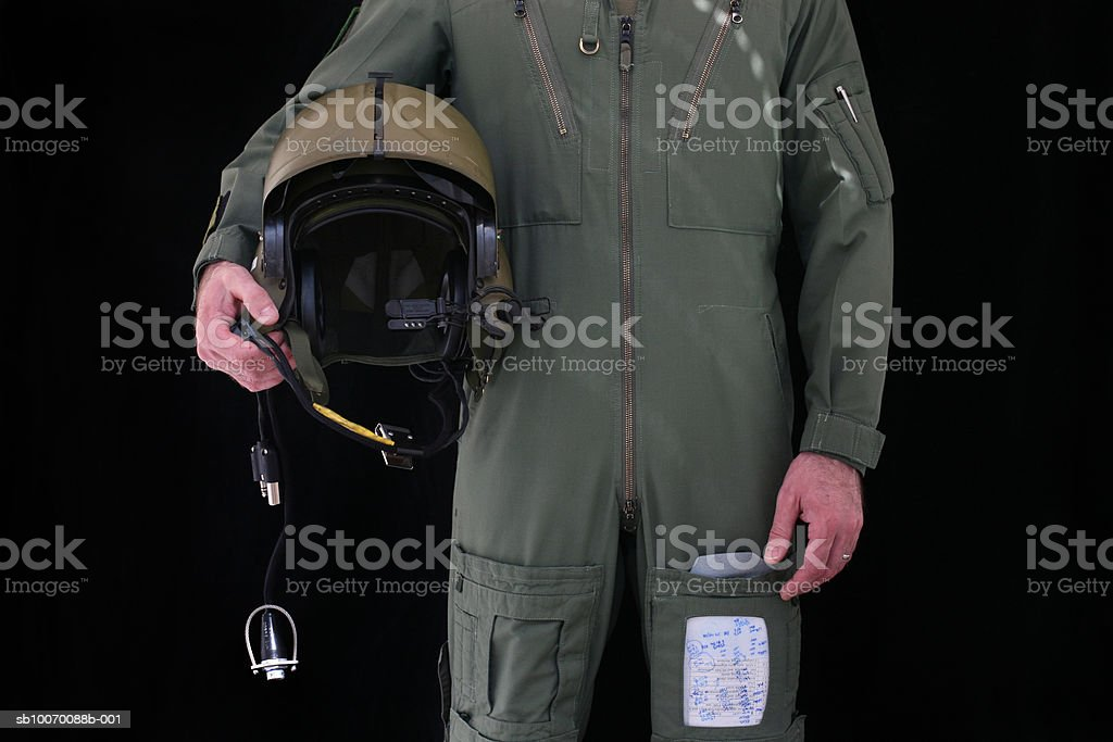Army pilot holding helmet, mid section foto de stock royalty-free