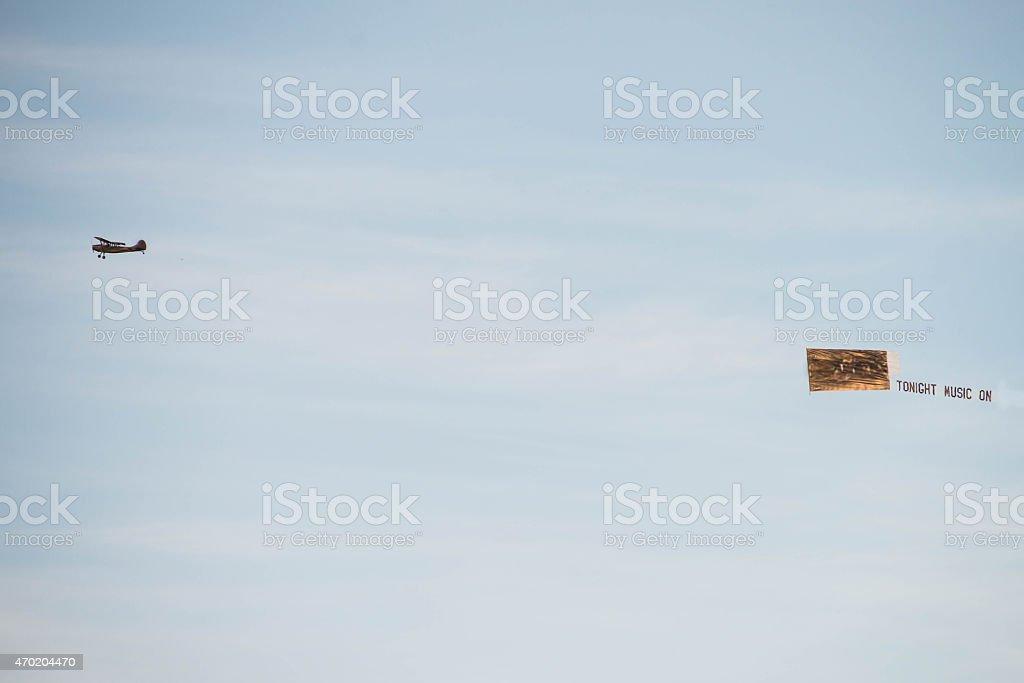 Army Plane Pulling Music Advertisement stock photo