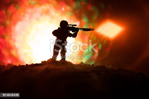 Army sniper with large-caliber sniper rifle seeking killing enemy. Silhouette on sky background. National security ensured, servicemen on guard. Battle scene