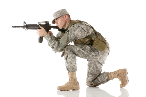 Army soldier aiming with a rifle