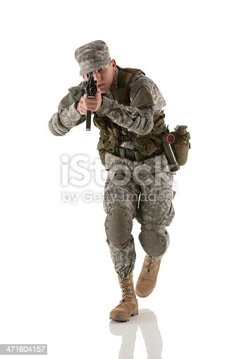 istock Army soldier aiming with rifle 471604157
