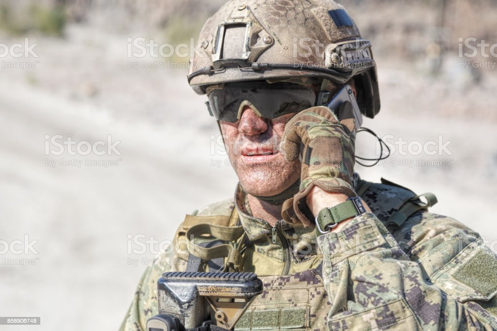 Army soldier calling stock photo