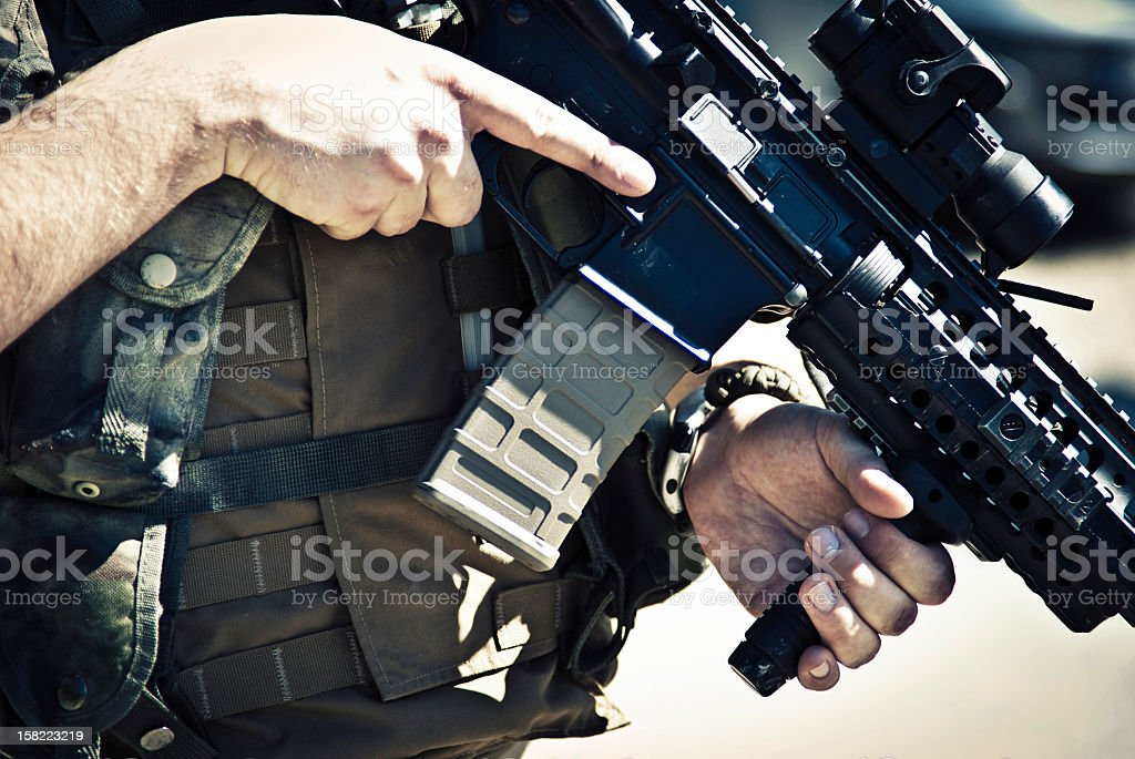 Army Soldier Carrying an M4 Assault Rifle stock photo