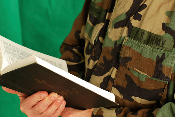 army soldier holding a bible stock photo