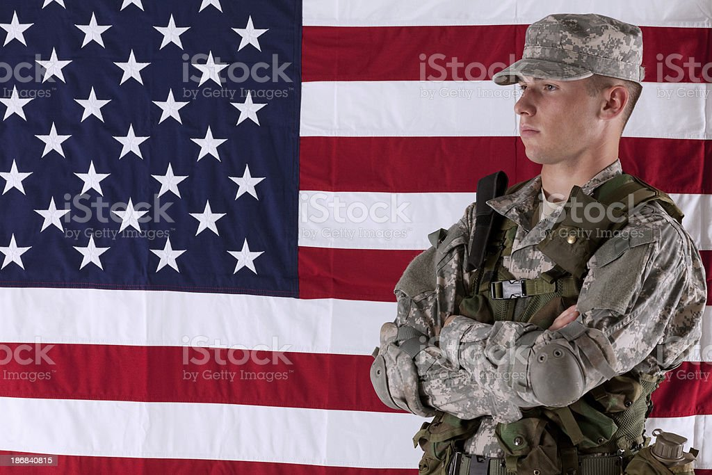 Army soldier in front of American flag royalty-free stock photo