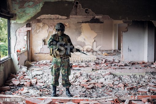 Special forces soldier with full equipment  in war zone