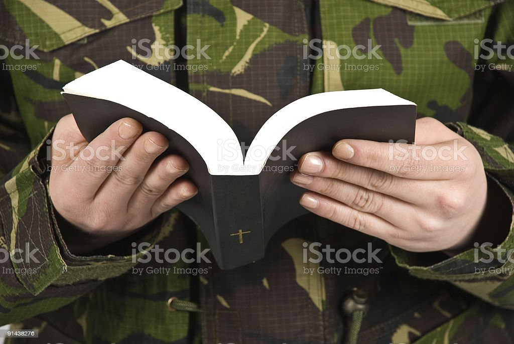 Army soldier reading bible royalty-free stock photo
