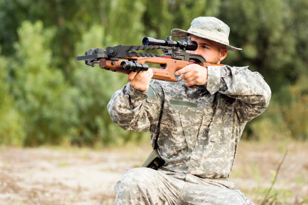 army soldier shooting with crossbow - crossbow stock pictures, royalty-free photos & images