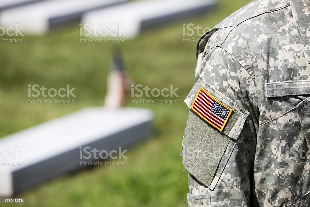 Army Soldier Uniform with American Flag Patch, Outdoors in Cemetery stock photo