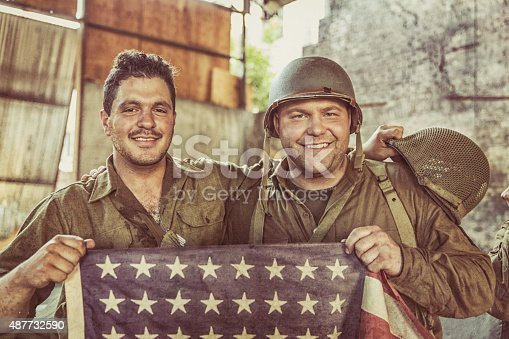 istock US Army Soldiers Holiding American Flag in Victory 487732590