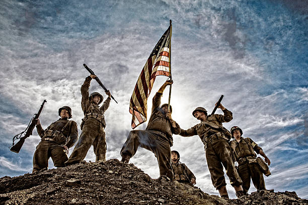 us army soldiers on hill with american flag - war memorial stock pictures, royalty-free photos & images