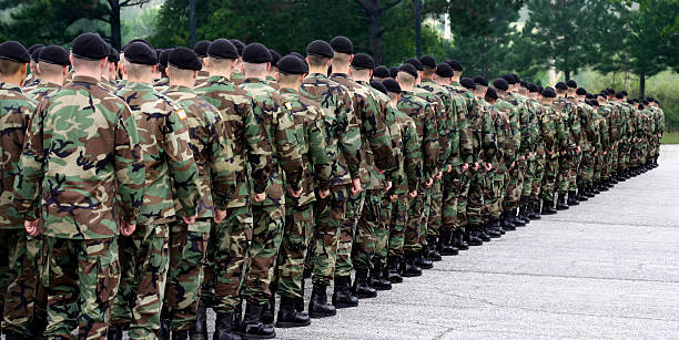 Army soldiers standing in a straight line Soldiers line up on the parade ground ready to begin their service. military parade stock pictures, royalty-free photos & images